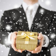 Man giving gift box — Stock Photo #31714693
