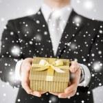 Man giving gift box — Stock Photo