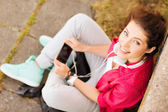 Girl with headphones listening to music — Stock Photo