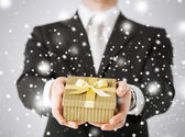 Man giving gift box — Stock Photo