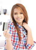 Happy teenage girl with credit card — Stock Photo