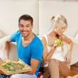 Couple eating different food — Foto de Stock