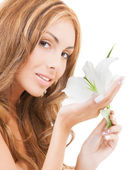 Lovely woman with white lily flower — Stock Photo
