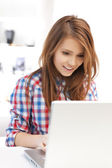 Smiling student girl with laptop at school — Stock Photo
