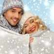 Stock Photo: Family couple under warm blanket