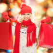 Teenage girl in winter clothes with shopping bags — 图库照片