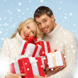 Happy man and woman with many gift boxes — Stock Photo