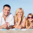 Stock Photo: Happy family on the beach