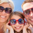 Stock Photo: Happy family with blue sky