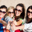 Teenage girls or young women showing thumbs up — Stock Photo