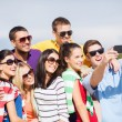 Group of friends taking picture with smartphone — Stock Photo #32146241