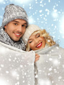 Family couple under warm blanket — Stock Photo