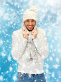 Handsome man in warm sweater, hat and scarf — Stock Photo