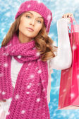 Woman in winter clothes with shopping bags — Stock Photo
