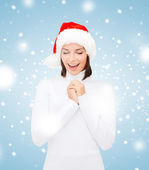 Surprised woman in santa helper hat — Foto de Stock