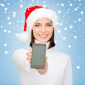 Woman in santa helper hat with smartphone — Stock Photo