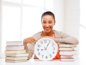 Attractive woman with white clock — Stock Photo