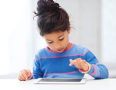 Girl with tablet pc at home — Stock Photo