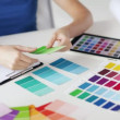 Woman working with color samples for selection — Stock Video