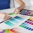 Woman working with color samples for selection — ストックビデオ