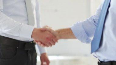 Business handshake - two businessmen shaking their hands — Stock Video