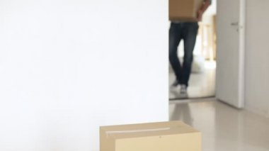 Footage of man moving big cardboard boxes — Stock Video