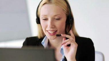 Footage of attractive helpline operator — Stock Video