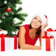 Smiling woman in santa helper hat with gift boxes — Stok fotoğraf