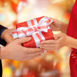 Man and woman hands with gift box — Stok fotoğraf