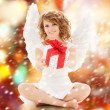 Happy teenage angel girl with christmas gift — Stock Photo
