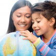 Mother and daughter with globe — Stock Photo #32432241