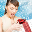 Happy woman with gift box — Stock Photo #32434455