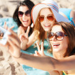 Girls taking self photo on the beach — Stock Photo