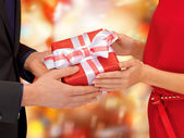 Man and woman hands with gift box — Stockfoto