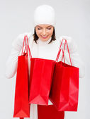 Picture of happy woman with shopping bags — Stock Photo