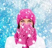 Surprised woman in hat, muffler and mittens — Stock Photo