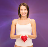 Beautiful woman in cotton underwear and red heart — Stock Photo