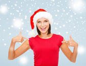 Smiling woman in santa helper hat — Stock Photo