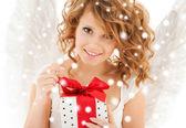 Happy teenage angel girl with christmas gift — Stock Photo