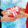 Man and woman hands with gift box — Stock Photo