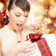 Happy woman with gift box — Stock Photo #32489023