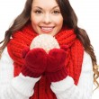 Woman in scarf and mittens with christmas ball — Stock Photo #32489515