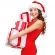 Woman in santa helper hat with many gift boxes — Stock Photo #32489545