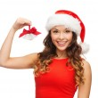 Woman in santa helper hat with jingle bells — Stock Photo #32489923