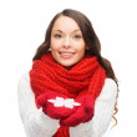 Woman with big snowflake — Stock Photo #32489989
