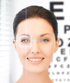 Woman and eye chart — Stock Photo
