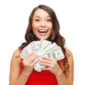 Woman in red dress with us dollar money — Stockfoto