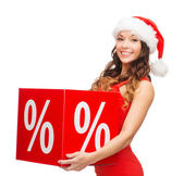 Woman in santa helper hat with percent sign — Stock Photo