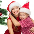 Happy mother and child boy in santa helper hats — Stock Photo #32490631