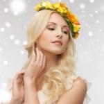 Woman wearing wreath of flowers — Stock Photo